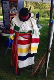 Our history is difficult, really: Hudson's Bay point blanket coat with Métis sash and hat. Ouch.